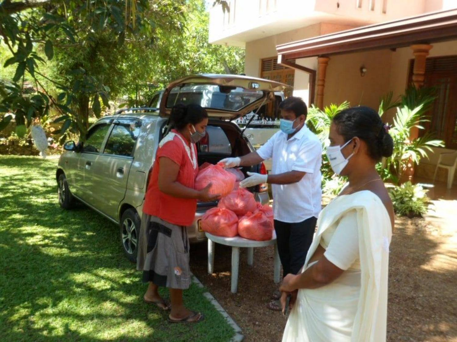 Distributing dry rations to low income families in Kalutara during Covid-19